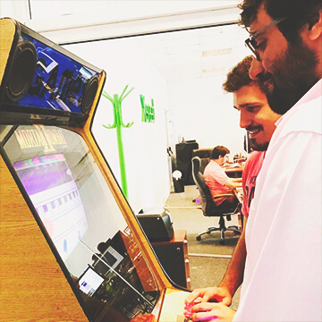 Two men playing a videogame